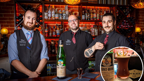 Cocktail makers Callum Hutchinson andJohn Cox with manager Jack Coughlan.
