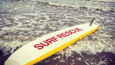 Lifeguard board in the surf at Goodrington