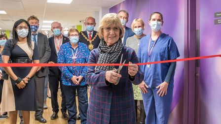 Woman cutting ribbon for new Crocus Medical Practice within Saffron Walden Community Hospital, Essex