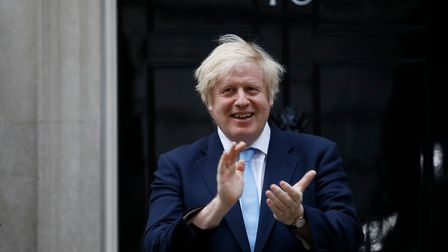 "Britain's Prime Minister Boris Johnson participate in a national ""clap for carers"" to show thanks fo"