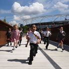 Children from the Bobby Moore Academy enjoying the newly opened footbridge connecting the Olympic Pa