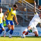 Dan Holman of Torquay United is challenged by Sam Magri of Havant & Waterlooville during the Emirate