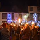 People gathered outside Ottery library to sing Christmas Carols