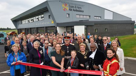 The Essex and Herts Air Ambulance CEO Jane Gurney declares the new base open, with help from patient Maisie Moon