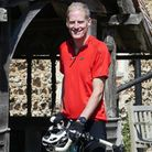 The Ven. Robin King, Archdeacon of Stansted, with his bike ahead of the Essex 'Ride & Stride' weekend
