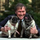 EDITORIAL USE ONLY File photo dated 10/10/13 of Conservative MP David Amess with his pugs, Lily and