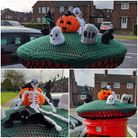 Halloween crocheted postbox topper with pumpkin, gravestones, skeleton and ghost figures on a Welywn Garden City postbox