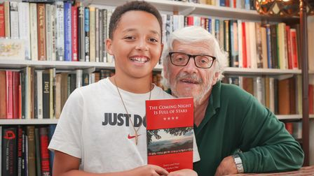 Author Robert E Pike of Saffron Walden with grandson Jacob with his book 'The Coming Night is Full of Stars'