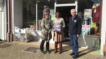 Lucie Heyburn, MP Kemi Badenoch and Rotary Club of Saffron Walden project organiser Alan Hawkes with a jigsaw puzzle
