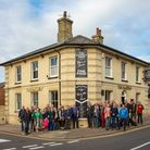 Group outside The Railway Arms in Saffron Walden, with new black and white signage