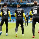 The Norwich players warm up wearing shirts showing support for Daniel Barden of Norwich, the young g