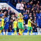 Teemu Pukki of Norwich reacts as Referee Andy Madley awards Chelsea a penalty after watching the VAR