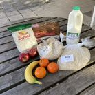 Rice, oats, milk, fruit and bread on an outdoor table