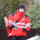 A Royal Mail delivery worker in Ashford, Kent, during England's third national lockdown to curb the
