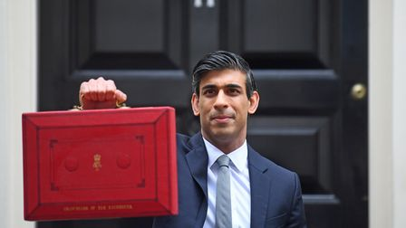 File photo dated 3/3/2021 of Chancellor of the Exchequer, Rishi Sunak, holds his ministerial 'Red Bo