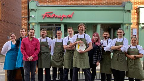 The staff of Farmyard on St Benedicts Street Norwich, with their third AA rosette which Chef Patron Andrew Jones is holding.
