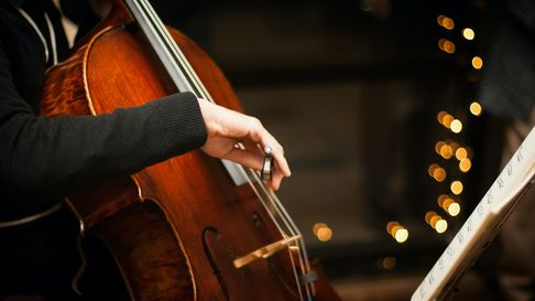 A close up of a cello being played