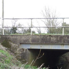 Armitage Bridge, which carries the B184 between Saffron Walden and Thaxted (Inset: A roadworks sign)