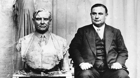 Labour politician Ernest Bevin poses beside a bronze bust made of him for a boardroom in 1930. Pictu