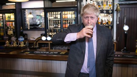 Boris Johnson drinks a pint of beer on a visit to the St Austell Brewery in Cornwall, during a Vote