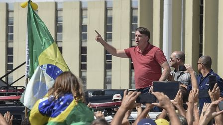 Brazilian President Jair Bolsonaro speaks after joining his supporters who were taking part in a mot