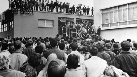1967 in San Francisco, demonstrators and newsmen cluster at San Francisco State College, during a de