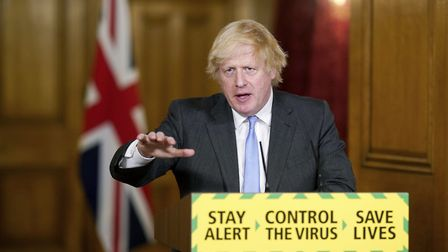 Handout photo issued by 10 Downing Street of Prime Minister Boris Johnson during a media briefing in