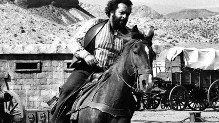 Italian actor and swimmer Bud Spencer (Carlo Pedersoli) riding a horse in the film A Reason to Live.