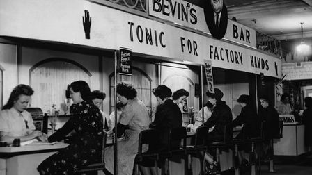 Women munitions and war workers receive manicures at Bevin's Bar, a beauty counter named after the M