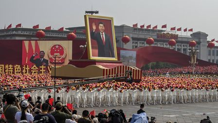 A giant portrait of Chinese President Xi Jinping is carried atop a float at a parade to celebrate th