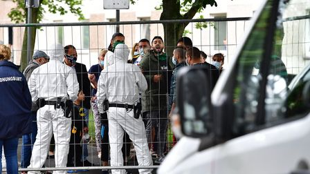GOETTINGEN, GERMANY - JUNE 19: Police forces wearing full protective suits prepare to enter the high