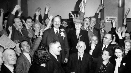 NEW DAWN: Prime minister Clement Attlee celebrates with supporters after Labour's surprise 1945 Gene