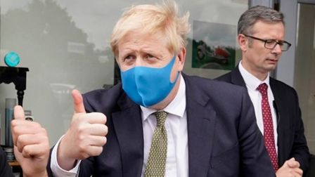 Boris Johnson wears a mask as he poses for a Twitter picture. Photograph: Twitter.