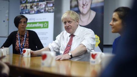 Boris Johnson speaks with health care professionals. Photograph: Peter Summers/PA.