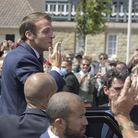 French President Emmanuel Macron leaves after voting in the municipal elections of Pas-de-Calais. Pi