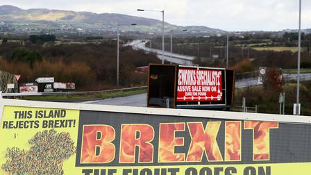 A Border Communities Against Brexit poster before its unveiling at a demonstration in Carrickcarnon