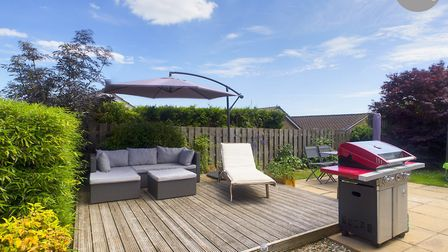 The rear garden includes a good-sized decking