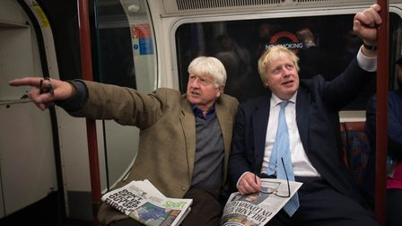 Boris Johnson sits next to his father Stanley (left) on the Bakerloo Line while mayor of London. Pho