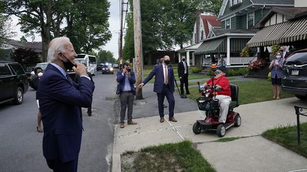 Democratic nominee for president Joe Biden stops to talk to residents as he tours his old neighborho