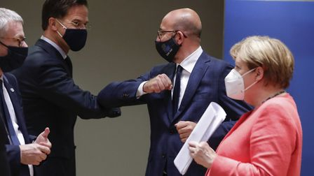 Dutch Prime Minister Mark Rutte, center left, elbow bumps with European Council President Charles Mi