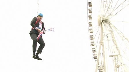Boris Johnson is left hanging in mid-air after he got stuck on a zipwire at an Olympic event at Vict