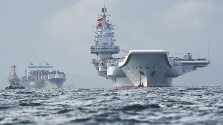 One of China's two aircraft carriers, the Liaoning (right of picture) in Hong Kong waters. Picture: