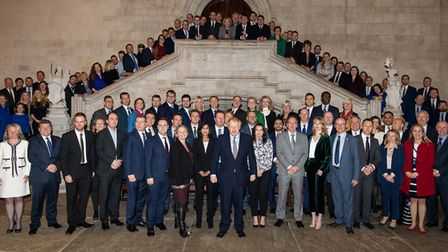 Prime Minister Boris Johnson poses with newly-elected Conservative MPs at the Houses of Parliament.
