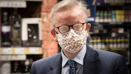 Chancellor of the Duchy of Lancaster Michael Gove buys a cigarette lighter from a shop near St James