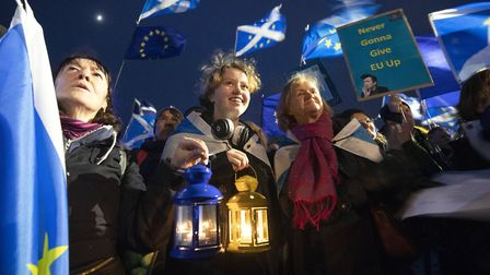 Pro-EU campaigners take part in a 'Missing EU Already' rally outside the Scottish Parliament. Photog