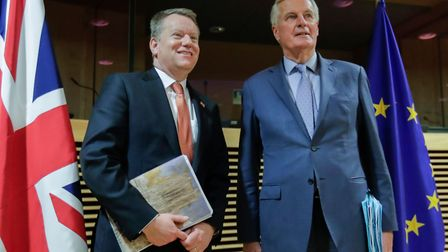 European Union chief Brexit negotiator Michel Barnier (R) and the British Prime Minister's Europe ad
