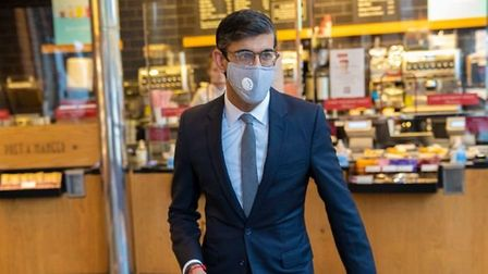 Chanellor Rishi Sunak pictured with his face mask leaving a Pret store; Twitter