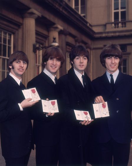 The Beatles outside Buckingham Palace after receiving their MBEs from the Queen. Photo: Hulton Archi