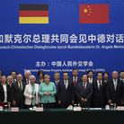 Chancellor of Germany Angela Merkel (C-L) and Chinese Premier Li Keqiang (C-R) take a group photo du