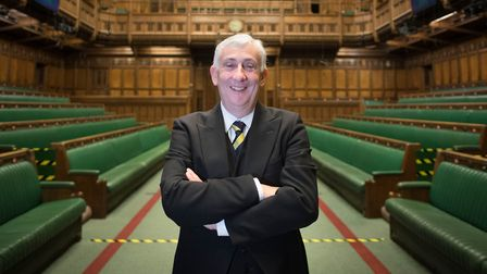 House of Commons Speaker Sir Lindsay Hoyle posses for a photograph in the chamber of the House of Co